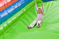 Little girl on the slide on the playground Royalty Free Stock Images