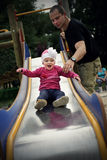 Little girl on the slide Royalty Free Stock Photos