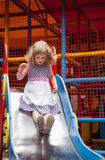 Little girl on a slide Royalty Free Stock Images
