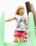 Little girl on a slide Stock Photo