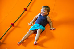 Little girl sliding down Stock Image
