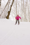 Little girl sliding down hill on ski Royalty Free Stock Photos