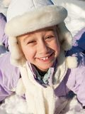 Little girl sliding in the snow Royalty Free Stock Photo