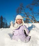 Little girl sliding in the snow Royalty Free Stock Image