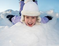 Little girl sliding in the snow Royalty Free Stock Photos