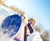 Little girl sliding in the snow Royalty Free Stock Photography