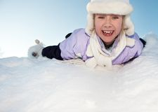 Little girl sliding in the snow Stock Photography