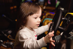 Little girl and slot machines Royalty Free Stock Image