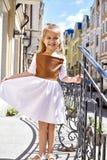 Little girl small baby pretty face wear fashion dress walk Royalty Free Stock Photo