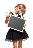 Little girl with small blackboard Stock Image