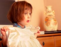 Little girl with small dress in arms royalty free stock photography