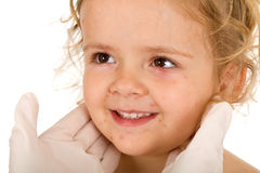 Little girl with small pox at the doctors Royalty Free Stock Images