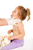 Little girl with small pox at the doctors Royalty Free Stock Image