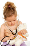 Little girl with small pox playing doctor Stock Photo