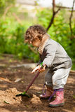 The little girl with a small shovel Stock Photo
