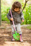 The little girl with a small shovel Royalty Free Stock Photos