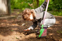 The little girl with a small shovel Royalty Free Stock Images