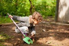 The little girl with a small shovel Stock Photos