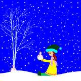 Little girl with small snowman Stock Image