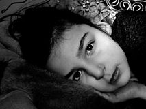 Little girl. Small woman lying on the blanket royalty free stock photo