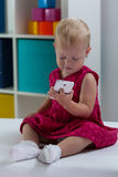 Little girl with smart phone Royalty Free Stock Photos