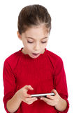 Little girl with smartphone Royalty Free Stock Images