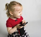Little girl with smartphone Stock Image