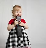 Little girl with smartphone Royalty Free Stock Image