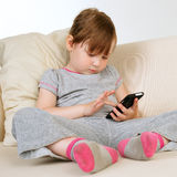 Little girl with a smartphone Stock Photo