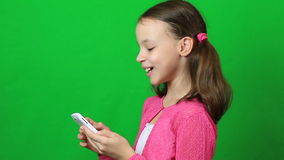 Little girl with smartphone in the hands laughing stock video