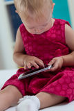 Little girl with smartphone Royalty Free Stock Photo