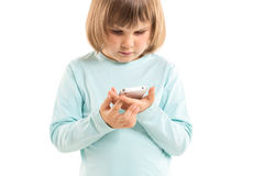 Little girl with smartphone Royalty Free Stock Photography