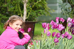 Little girl smell tulip flower Royalty Free Stock Photography
