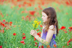 Little girl smelling a bunch of flowers Royalty Free Stock Image