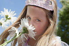 Little girl smelling flowers Royalty Free Stock Image