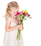 Little girl smelling flowers Stock Photos