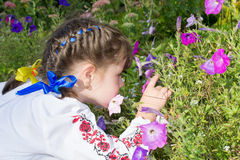 Little girl smelling flowers Royalty Free Stock Photography