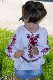 Little girl smelling flowers Stock Image
