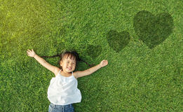 Little girl smile. Asian little girl smile and lay on grass Royalty Free Stock Image