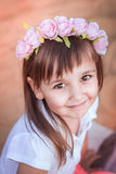 A little girl with a smile. A beautiful little girl with a smile looking at the camera Royalty Free Stock Photos