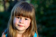 Little girl smile at the camera. Portrait of happy, positive, sm. Iling, playful caucasian girl with beautilul hair Royalty Free Stock Photos