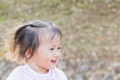 Little Girl Smile : happily smiling girl walks in the park with her family sunset time Stock Images