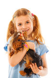 Little girl smile and hold cute small dog Stock Photography