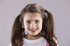 Little girl smile. Portrait with gray background Stock Photo