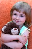 The little girl smiles. The little girl with toy a bear Stock Image