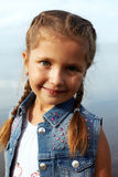 Little girl smiles at the camera Stock Image