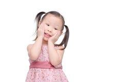 Little girl smiles over white Stock Photography