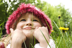 Little girl smiles in the park Royalty Free Stock Image