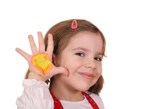 Little girl with smiley on hand Stock Images