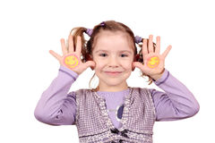 Little girl with smiley on hands Stock Photo